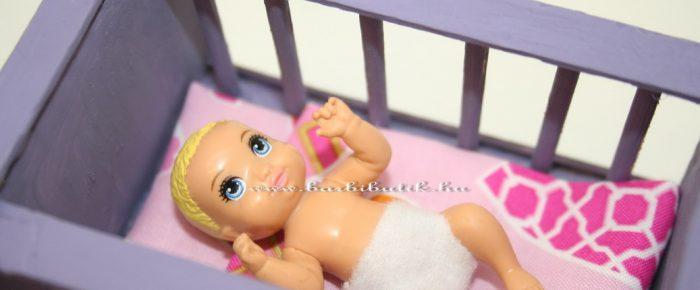 Babaágy Barbie kisbabájának